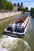 Tourist boat in Paris. Wide angle view.