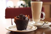 stock photo of chocolate muffin  - Chocolate Muffin And Coffee Latte on background - JPG