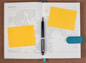 World Atlas Diary Book With Yellow Paper Note. Open Diary Map Book With World Map With Pen. Black Pe poster