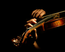 picture of musical instrument string  - Musician playing violin isolated on black - JPG