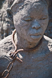 picture of slavery  - Statue of a woman in slavery posed in Stone Town Zanzibar where once was placed the slave market - JPG