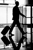 stock photo of hustle  - The hustle and bustle of a busy airport - JPG