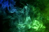 Cloud Of Blue And Green Smoke On A Black Isolated Background. Background From The Smoke Of Vape poster
