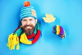 Happy Smiling Bearded Man With Autumnal Maple Yellow Leaf In Hand. Bearded Man In Colorful Hat Look  poster