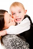 stock photo of stepmother  - Naughty little boy crying mother wants to calm him down - JPG