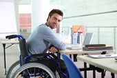 stock photo of wheelchair  - Businessman in a wheelchair - JPG