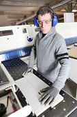 Man wearing ear defenders in a factory