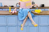 Colorful Retro / Pin Up Girl Woman Female Housewife Wearing Yellow Top, Skirt And White Apron Sittin poster