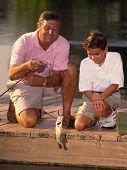 Boy And Grandfather Fishing 2