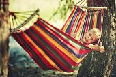 Funny Little Boy Playing In Hammock, Child Resting In Garden poster