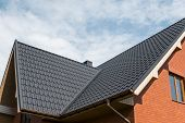 Modern Roof Covered With Tile Effect Pvc Coated Brown Metal Roof Sheets. poster