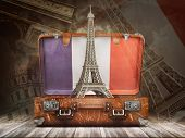 Trip to Paris. Travel or tourism to France concept. Eiffel tower andvintage suitcase with flag of Fr poster