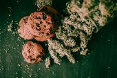 The Concept Of Cookies Chocolate With Cbd And Thc Are On A Black Table With Cannabis Buds. Marijuana poster