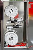 picture of firehose  - Two spools of high pressure fire hoses - JPG