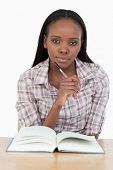 Young woman reading a novel against a white background
