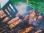Barbecue Grilling Shish Kebab. Clos Up View. Grill, Frying Fresh Meat, Chicken Barbecue, Sausage Con poster