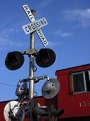 stock photo of caboose  - Criss Cross Rail Road Crossing Sign lights and a red caboose in midwest America - JPG