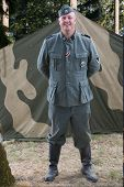 German Ss Officer  Re-Enactor Standing In Front Of Tent.