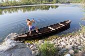 Oarsman On River