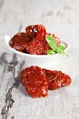 Dried Tomatoes With Basil Leaves.