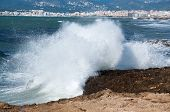 Splashing wave in front of Palma de Mallorca.