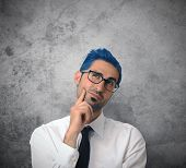 stock photo of exaltation  - Che creative thinking businessman with blue hair - JPG