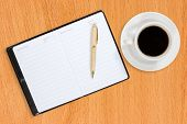 Notebook And Coffee Cup On The Table