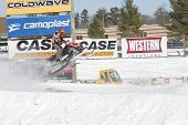 Polaris Red & Black Snowmobile Soaring On Jump