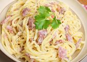Spaghetti alla carbonara with parmesan cheese and freshly ground pepper