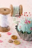 Handmade Pincushion On Floral Fabric Background