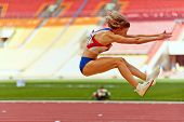 MOSCOW - JUN 11: Female athlete makes long jump at Grand Sports Arena of Luzhniki OC during Internat