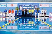 MOSCOW - APR 13: Athletes stand near to victory podium before awarding at Pool of SC Olympic on day