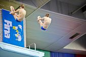 MOSCOW - APR 13: Athletes perform exercise during competitions on syncronized springboard diving in