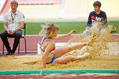 MOSCOW - JUN 11: Female jumper in sandpit at Grand Sports Arena of Luzhniki OC during International athletics competitions IAAF World Challenge Moscow Challenge, June 11, 2012, Moscow, Russia.