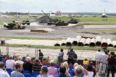 ZHUKOVSKY - JUNE 25: Spectators and dancing tanks at second International Forum Engineering Technolo