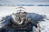 Bizarre burnt out snowmobile on Yukon lake Canada