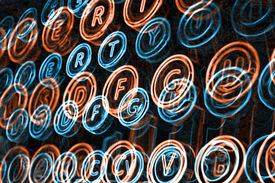 foto of qwerty  - Neon typewriter keys close up selective focus - JPG