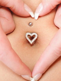 stock photo of pierced belly button  - woman - JPG