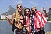 Sport fans with USA Flag in Rio de Janeiro with Christ the Redeemer in background.