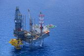 stock photo of helicopter  - Top view of helicopter pick up passenger on the offshore oil rig - JPG