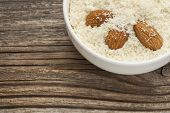 almond flour high in protein, low in carbohydrates, low in sugars and gluten free - a ceramic bowl o
