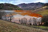 Contaminated Lake Full With Mining Waste Residuals In Rosia Montana, Romania