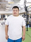 Overweight Man standing In Gym