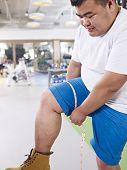 Overweight Man In Gym
