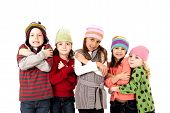 foto of shivering  - funny children in winter hats shivering cold