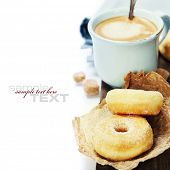 Coffee break with fresh sugary donuts over white background (with easy removable sample text)