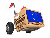 image of hand truck  - Cardboard Box with Flag of European Union and Made in European Union Slogan on Hand Truck White Background - JPG