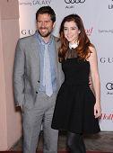LOS ANGELES - DEC11:  Alexis Denisof & Alyson Hannigan  arrive to Women in Entertainment Breakfast 2013  on December 11, 2013 in Hollywood, CA