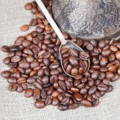 Roasted Coffee Beans And Copper Pot