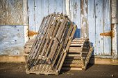 foto of lobster trap  - Lobster traps propped up on a wharf in rural Prince Edward Island - JPG